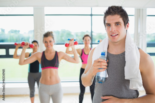 Man taking break from aerobics class