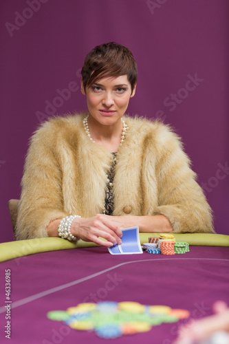 Angry woman at poker table