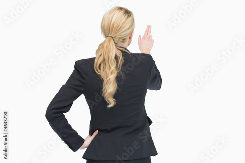 Businesswoman pointing out something
