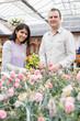 Smiling couple choosing flowers