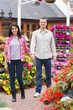 Couple holding hands in garden center