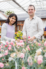 Smiling couple choosing flowers