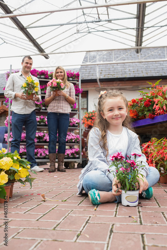 Happy family holding flower pots