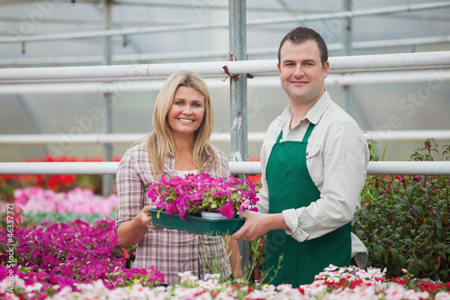 Woman and florist holding a box of flowers
