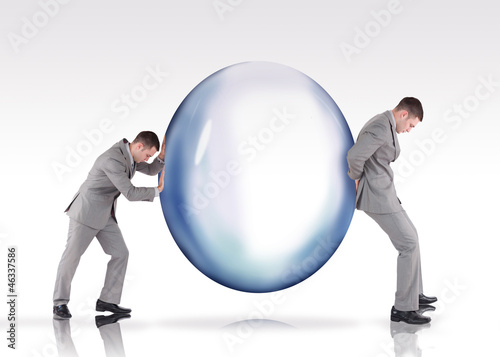 Businessmen pushing a bubble