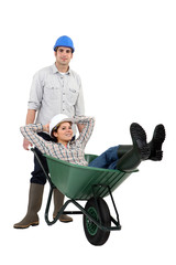 Builders and wheelbarrow