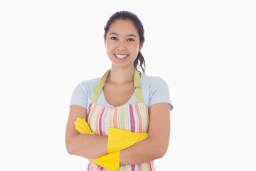 Smiling woman wearing apron and rubber gloves