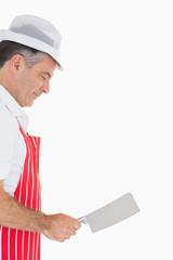 Butcher wielding meat cleaver
