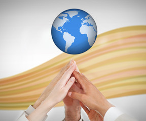 People reaching hands to the globe