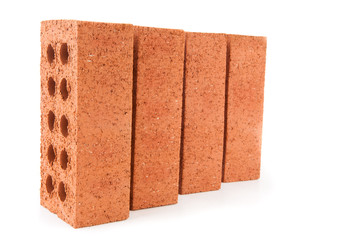 Four red bricks positioned in a row