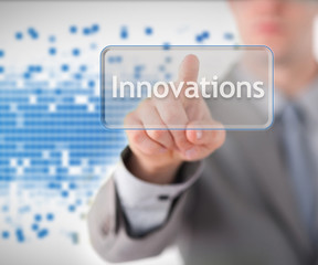 Businessman standing while pointing to the word innovation