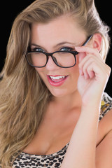 Sultry woman holding her glasses