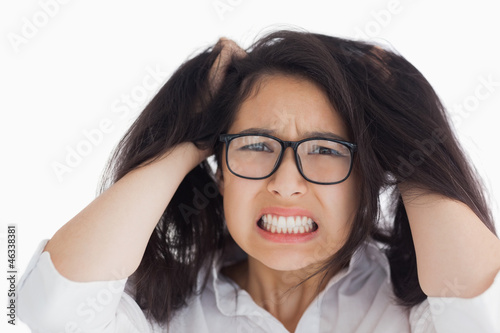 Worried woman putting her hand on the head