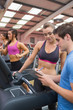Gym Instructor helping woman