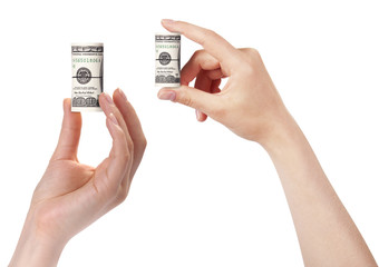 female hands with money set isolated on a white. Dollars
