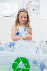 Girl sitting by boxes with plastic