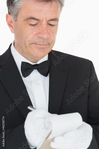 Waiter writing into his notebook