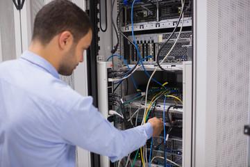 Man adjusting servers