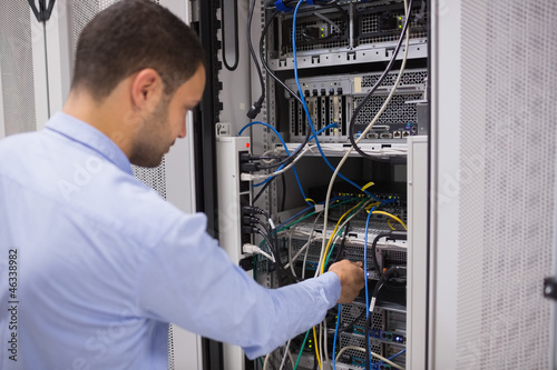 Man adjusting servers