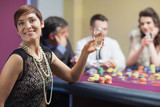 Happy woman at roulette table
