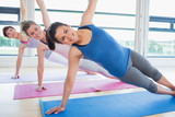Smiling women in yoga class