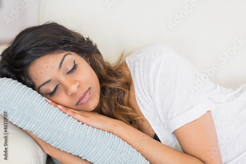 Woman resting her head on a pillow