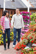 Couple walking in garden centre