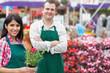 Two smiling garden center employees