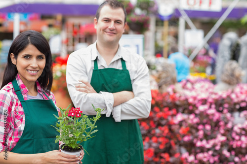 Two smiling garden center employees