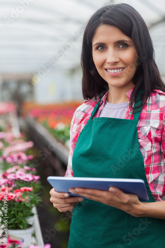 Woman doing inventory in greenhouse