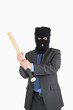 Smiling businessman in a balaclava with a baseball bat