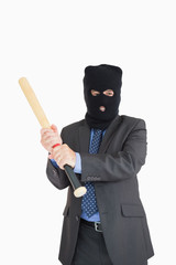 Smiling businessman in a balaclava with a baseball bat