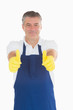 Man in rubber gloves giving thumbs up