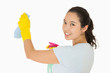 Smiling woman cleaning walls