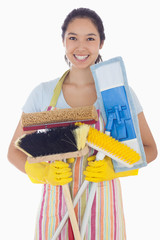Woman holding mops and brushes