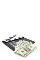 Slate and money lying