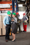 Supervisors With Digital Tablet Working At Warehouse