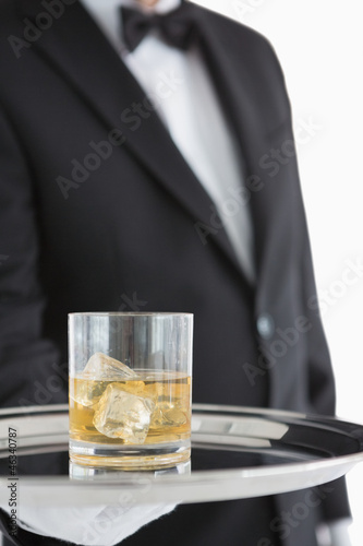 Man holding tray with whiskey