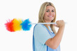 Smiling cleaning woman holding feather duster