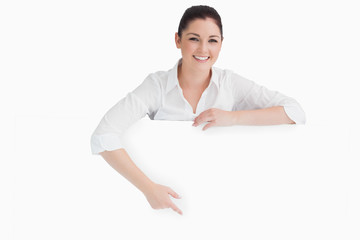 Woman pointing to white board
