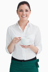 Waitress holding cup