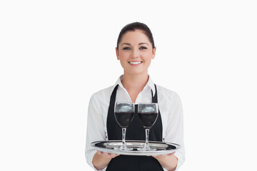 Waitress holding wine