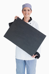 Chef holding blackboard