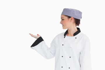Chef holding hand out to left