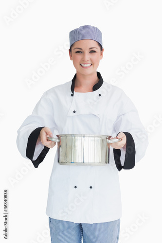 Cook holding a pot
