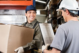 Warehouse Worker Looking At Supervisor With Clipboard poster