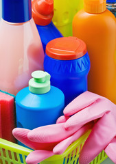Various cleaning products and pink rubber gloves