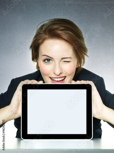 canvas print picture Business woman winking over her tablet pc with copyspace