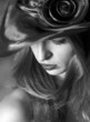 Portrait of the girl in a hat. Black and white