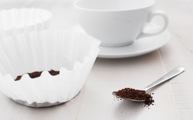 Paper coffee filter and ground coffee